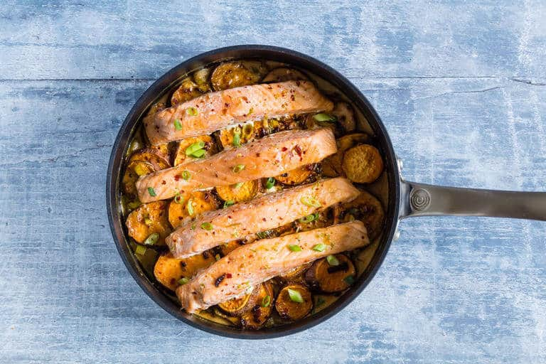 Easy lime coconut salmon and sweet potato bake recipe. A one pot recipe with tender salmon on sweet potato with zesty flavours. recipesfromapantry.com