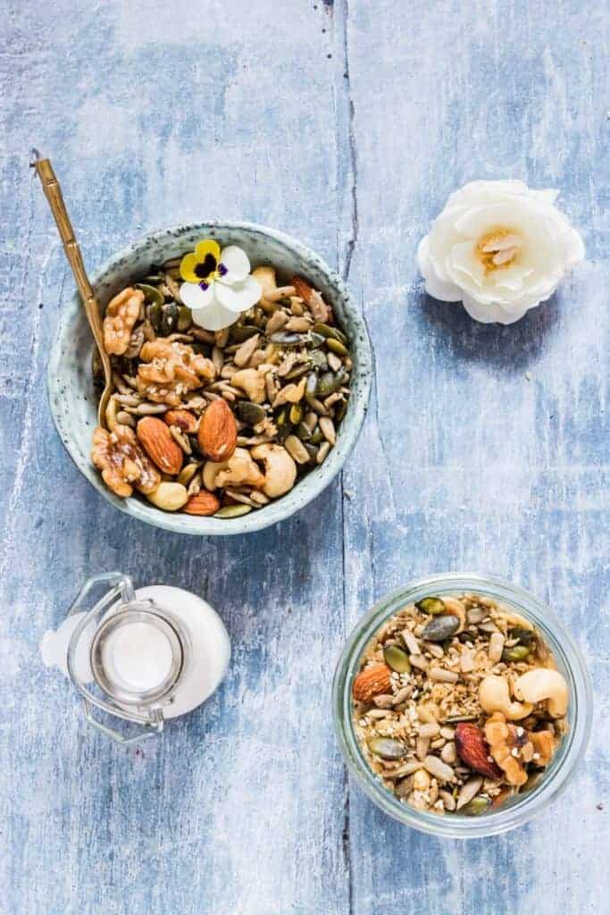 Delicious slow cooker low carb granola made with mixed nuts, seeds, coconut, cardamom and nutmeg and served with milk. It is gluten-free and refined sugar free. recipesfromapantry.com #lowcarbgranola #sugarfreegranola #crockpotgranola #slowcookergranola #granola #grainfreegranola