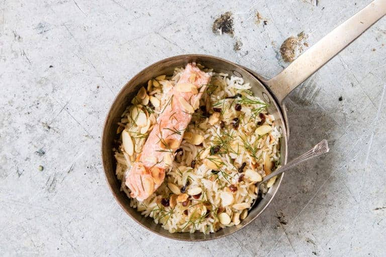 one pan salmon rice with a spoon