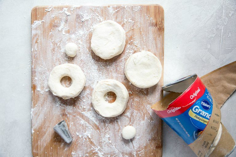 air fryer donuts being cut out using biscuit dough