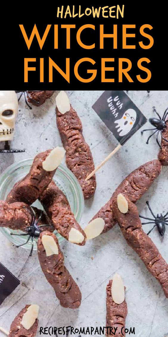 chocolate cookies shaped like witches fingers surrounded by plastic spiders