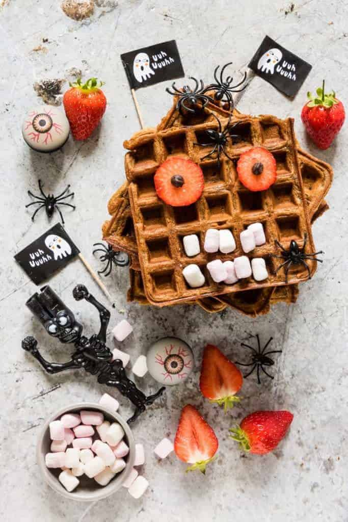 Delightfully fluffy & easy chocolate chip sweet potato waffles recipe with a Halloween twist your guests will love. See more at recipesfromapantry.com #sweetpotatowaffles #easysweetpotatowaffles #chocolatechipwaffles #sweetpotatochocolatechipwaffles #wafflerecipes