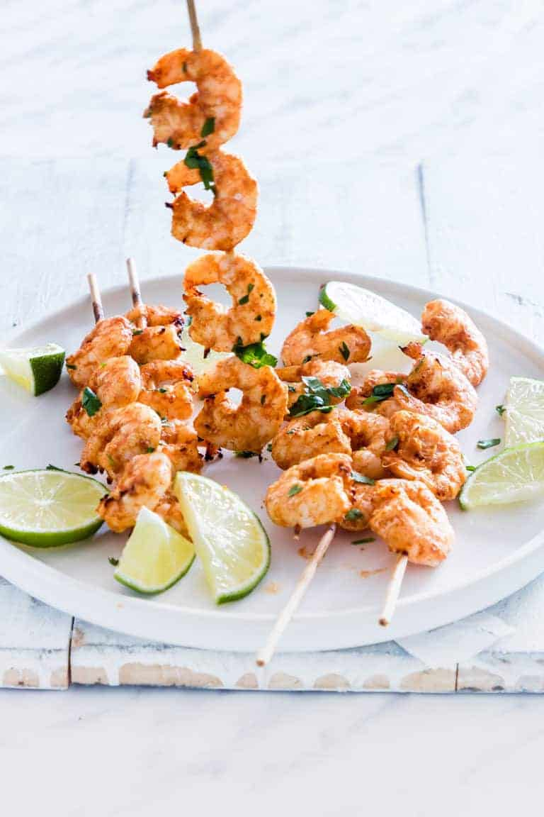 air fryer shrimp skewer being pick up