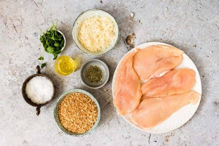 Ingredients for easy baked parmesan crusted chicken - chicken, salt, panko breadcrumbs, oil, parmesan, herbs