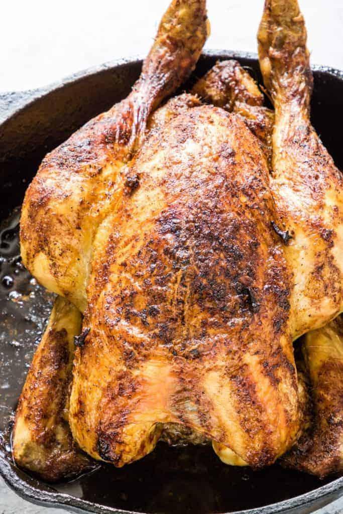 Overhead shot of roast orange chicken in a skillet