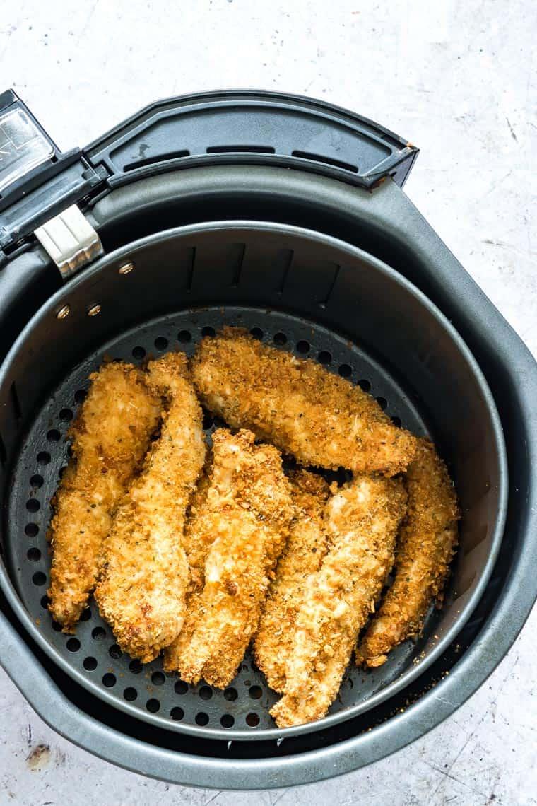 cooked air fryer chicken tenders inside the air fryer basket