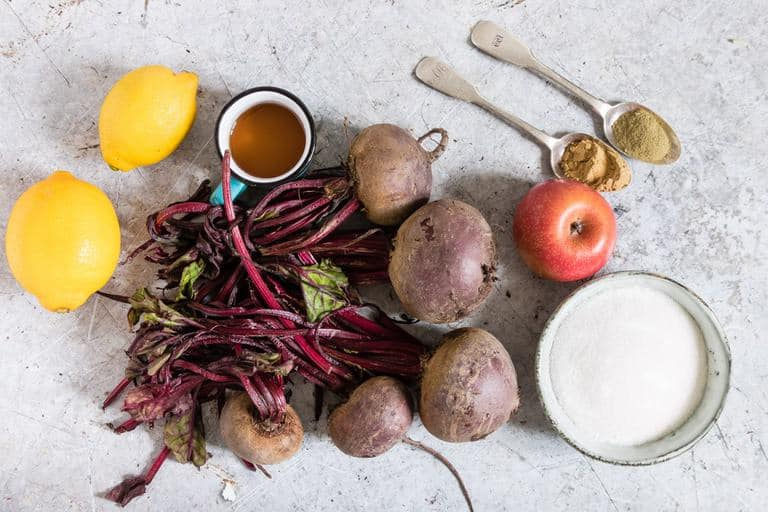 fresh beets, lsmons, an apple, and other ingredients for beetroot relish