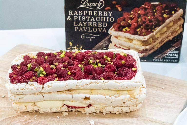 Iceland foods raspberry pistcahio layered pavlova on table