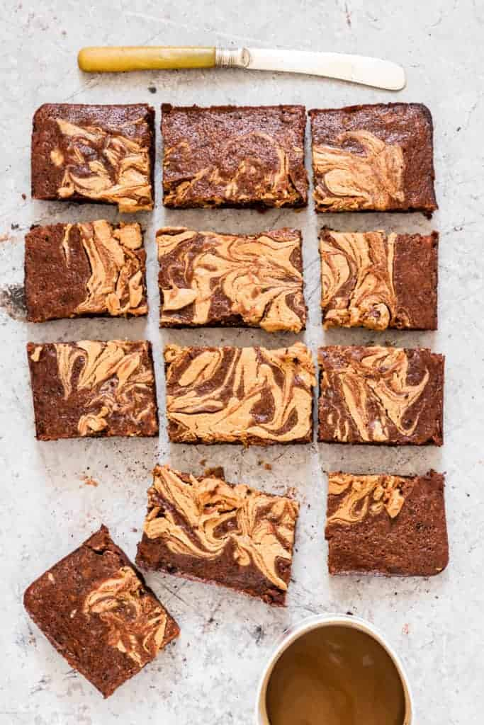 Banana brownies (vegan brownies) cut into 12 pieces with a knife and coffee