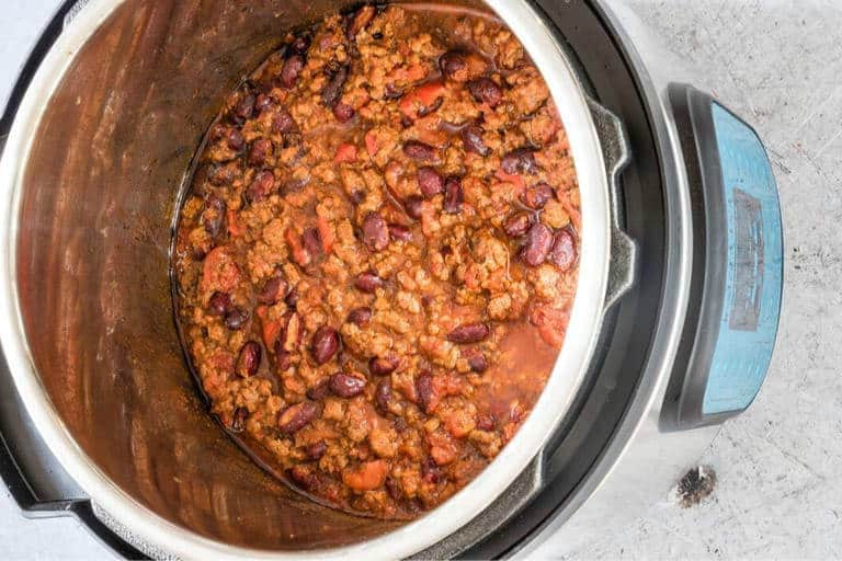 overhead view of fully cooked venison chili (venison chilli) inside an instant pot