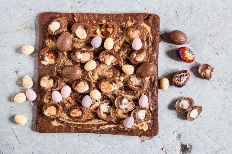 Cadbury Crème Egg Brownies - sliced and topped with extra creme eggs around