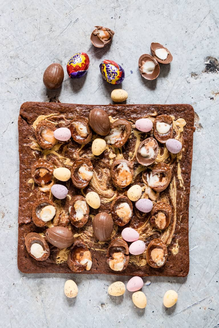 Cadbury Crème Egg Brownies - sliced and topped with extra creme eggs