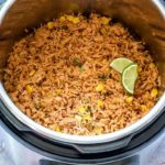 close up image of instant pot mexican rice in an Instant Pot garnished with greens