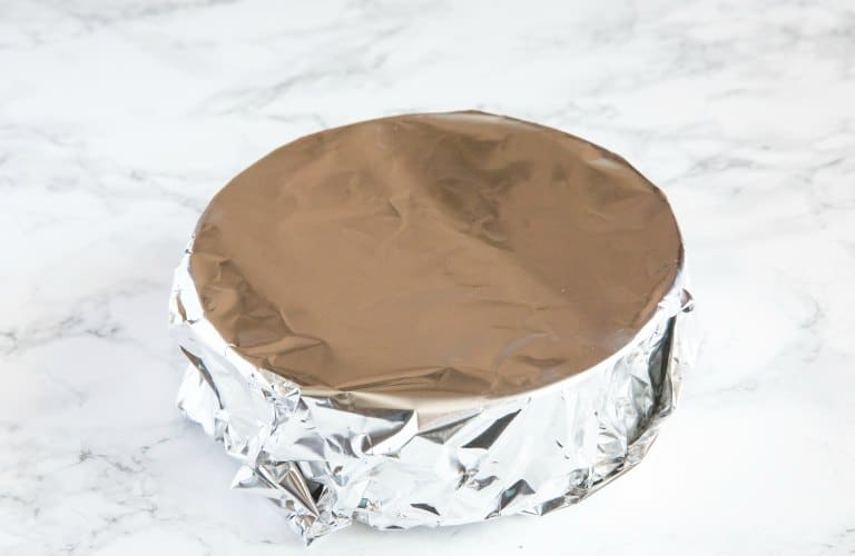 instant pot cheesecake fully covered in foil on countertop