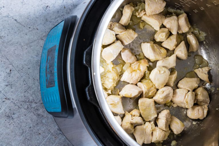 instant pot containing chicken pieces cooking for instant pot white chicken chili