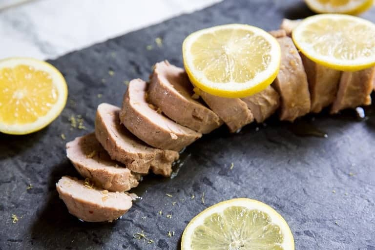 sliced instant pot pork tenderloin on a black countertop
