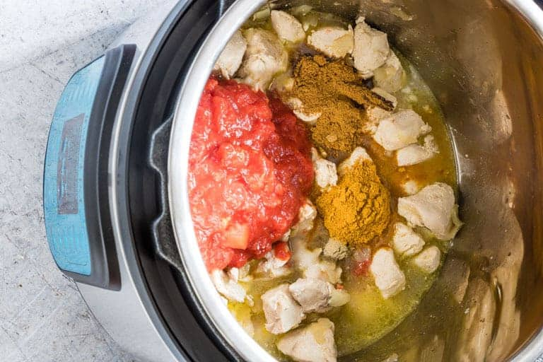 instant pot chicken curry ingredients uncooked inside instant pot inner pot