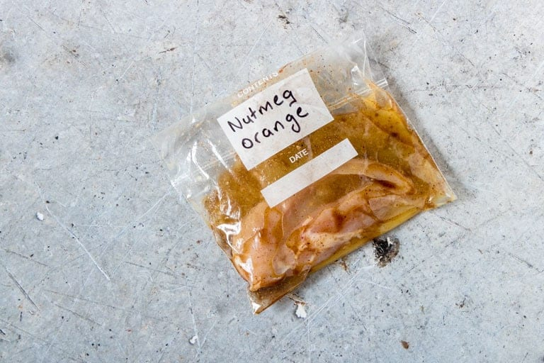 nutmeg orange chicken marinades in a ziploc bag