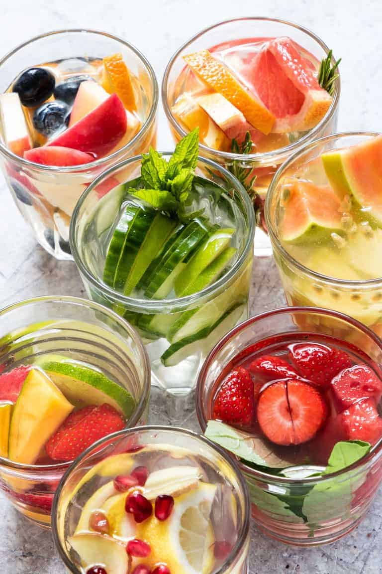 7 fruit infused water glasses on a table