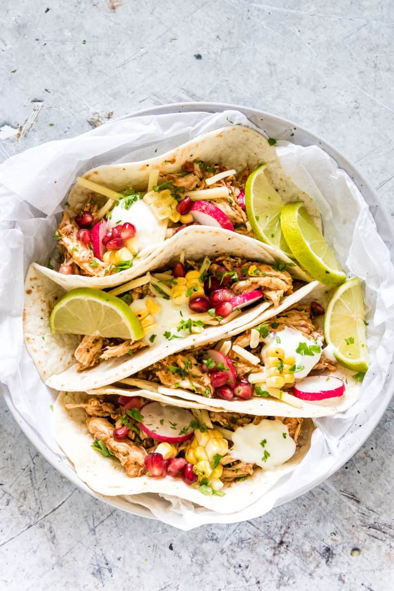 A bowl of instant pot shredded chicken tacos