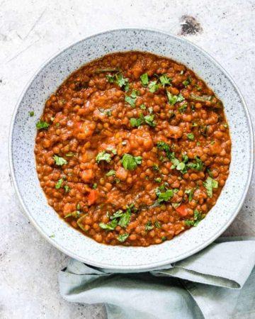 a bowl of instant pot lentils soup