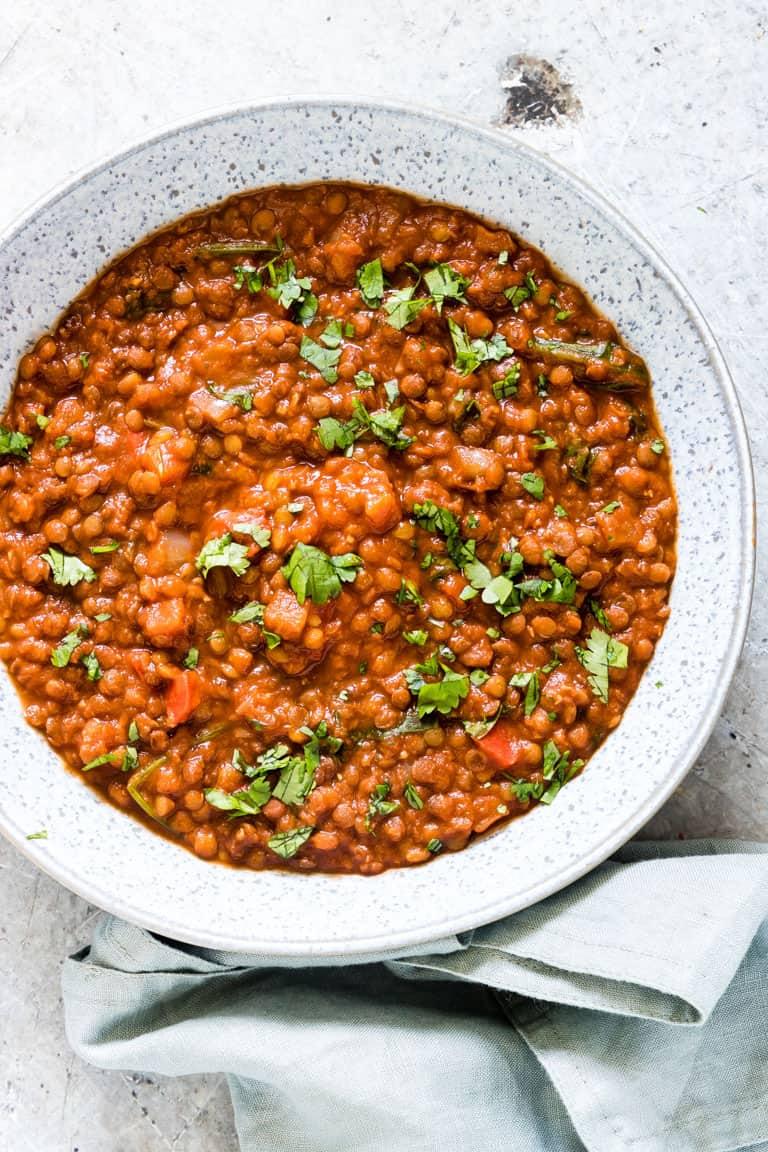 a bowl of instant pot lentil soup with a spoon
