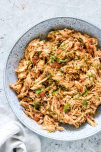 A bowl of instant pot shredded chicken