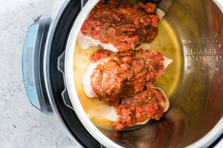 uncooked chicken breast in Instant Pot, for instant pot shredded chicken with salsa