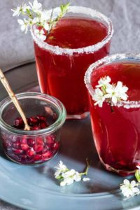 2 glasses of Pomegranate Martini with pomegrante seeds