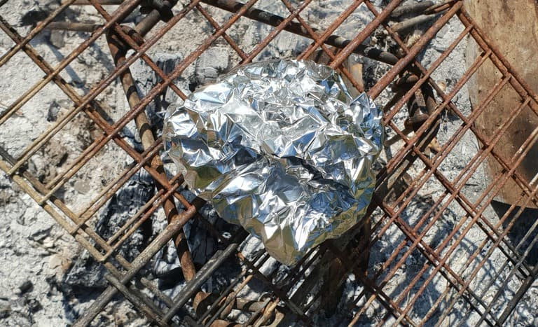 Shrimp Foil Packet on a campfire