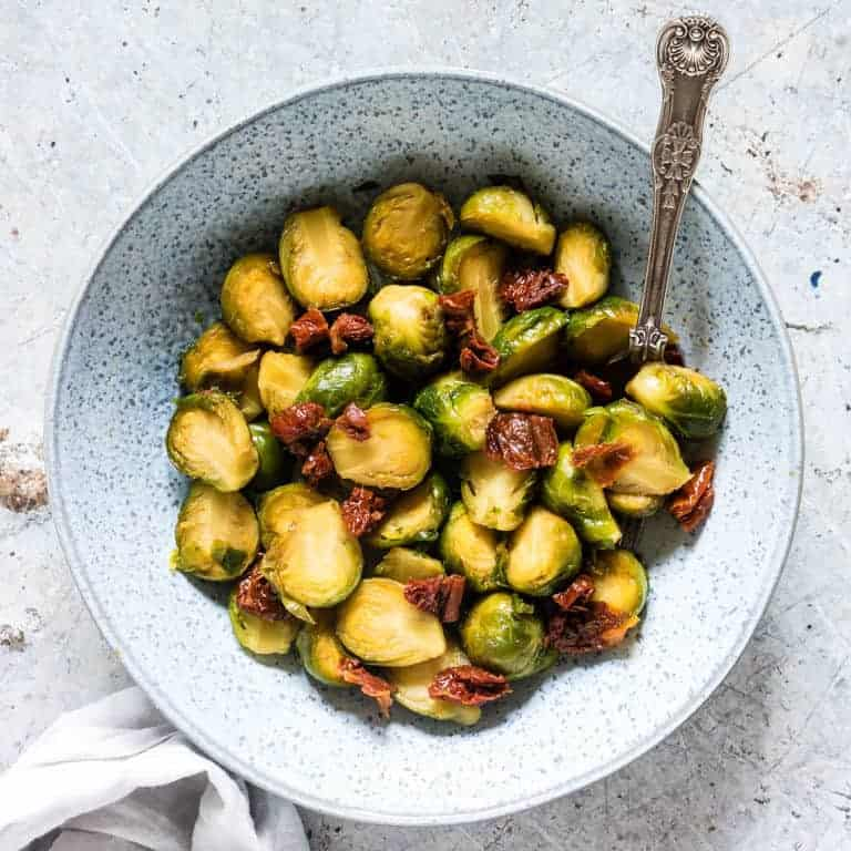 a plate of instant pot brussel sprouts with sundried tomatoes