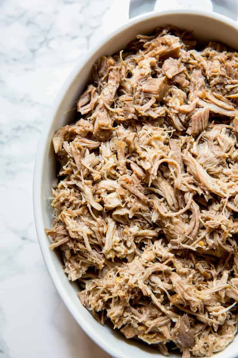 overhead view of large casserole dish filled with instant pot pulled pork