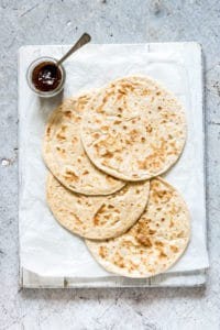 rotis on a board with chilli