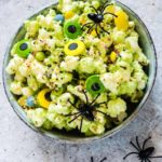 a bowl of Halloween Popcorn Mix / halloween snack for kids