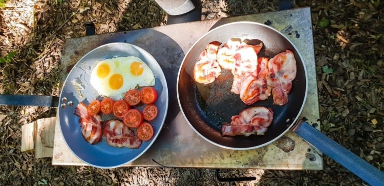 cooking breakfast at Feather Down Farms Glamping UK