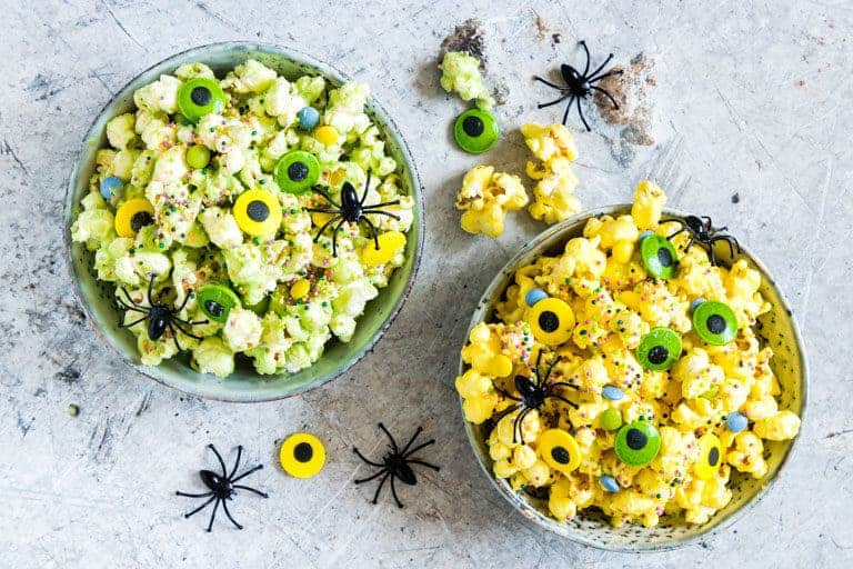 2 bowls of party popcorn in a a halloween theme
