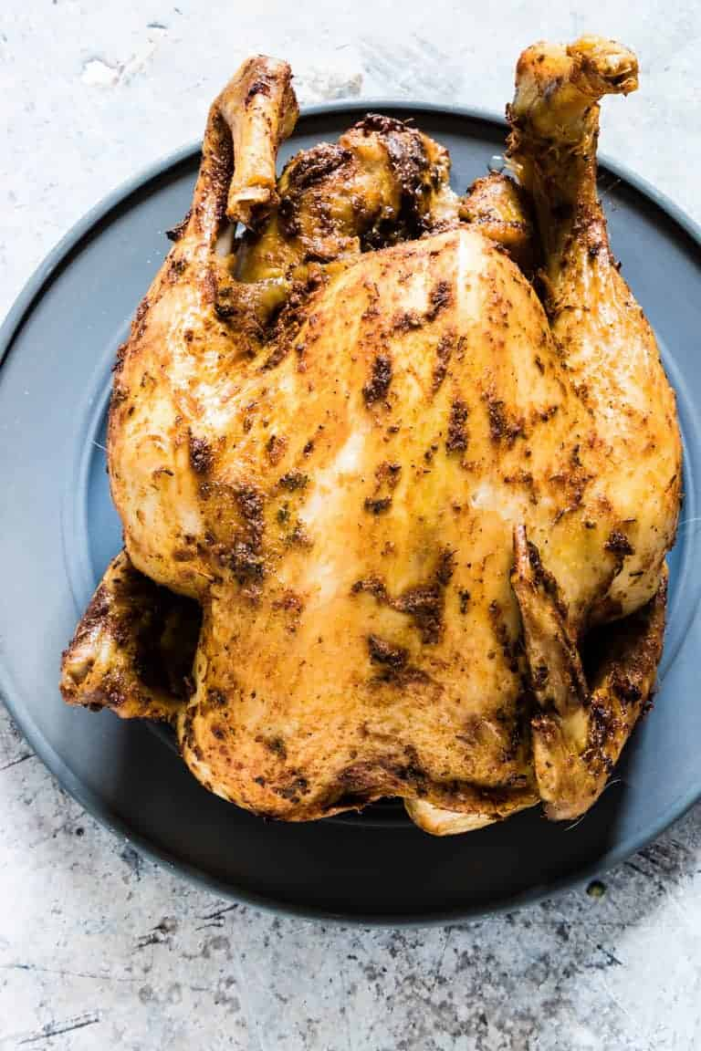whole chicken in the slow cooker on a plate
