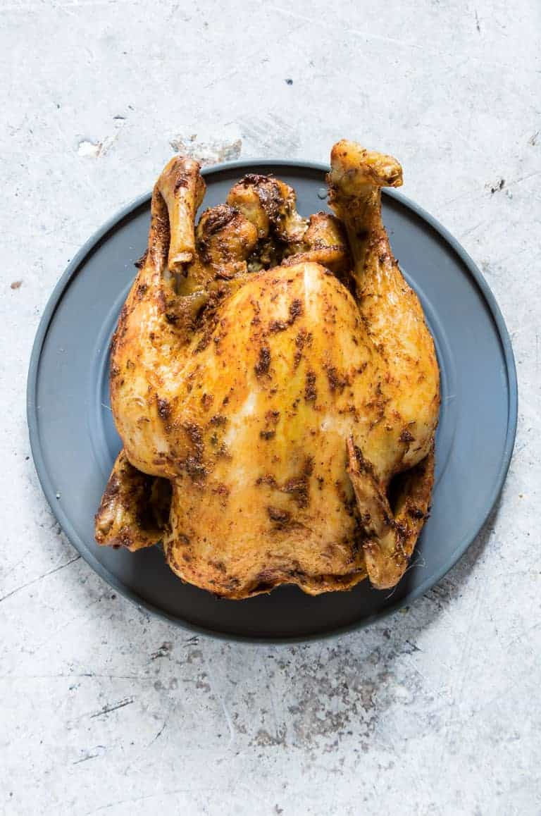 a slow cooker whole chicken on a table