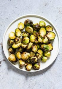 a bowl of crispy air fryer brussel sprouts