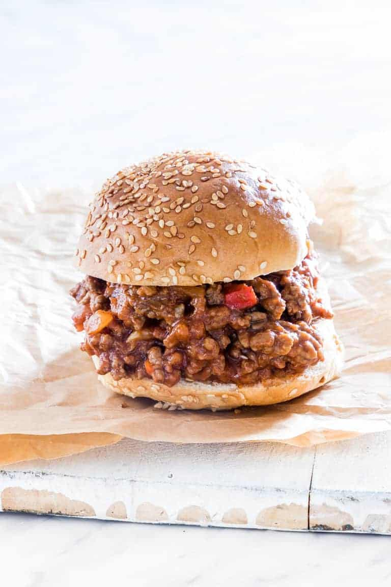 A completed serving of Instant Pot Sloppy Joes sitting on a piece of parchment paper