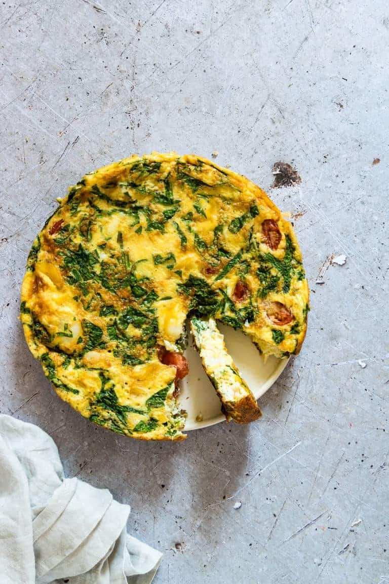 Cooked Smoked Haddock and Spinach Frittata with one slice removed