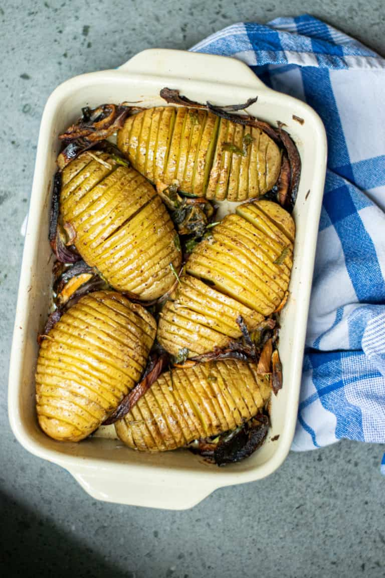 A tray of Cooked Hasselback potatoes