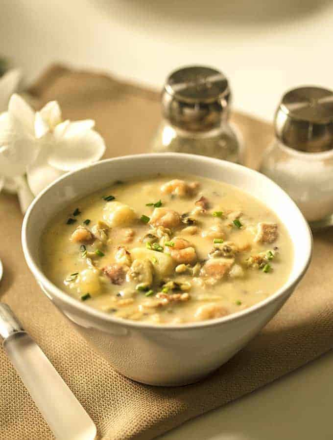 instant pot clam chowder with shrimp served in a white bowl