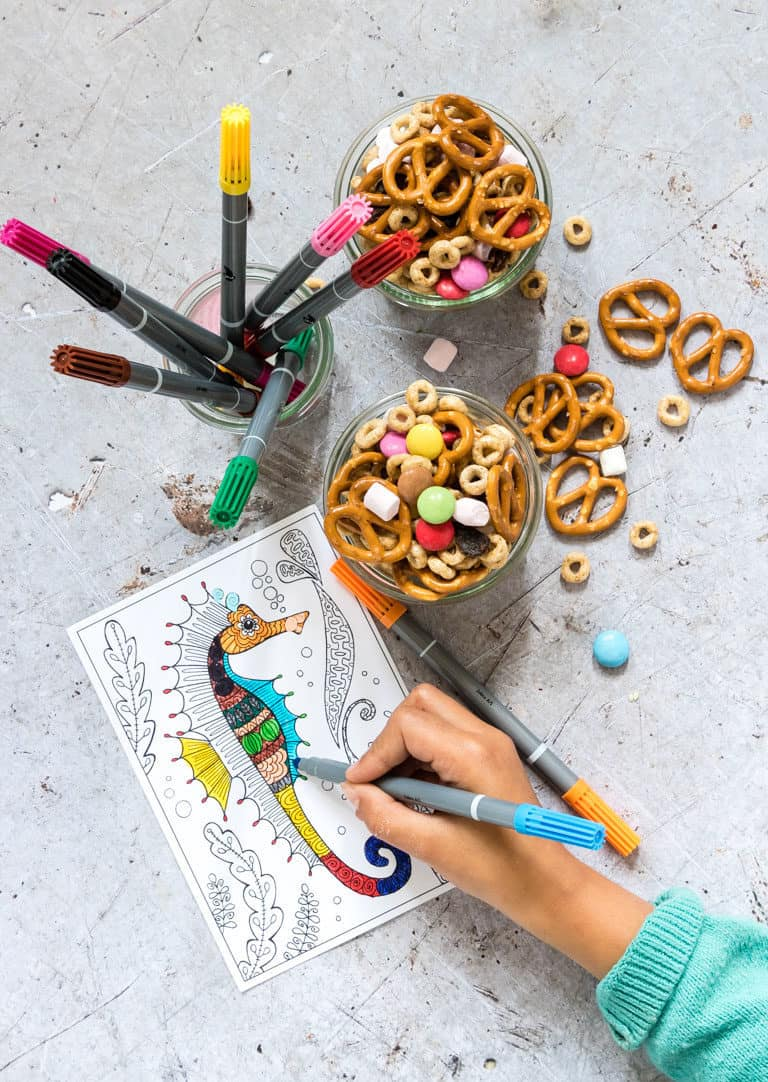 sweet and salt snack mix with a child colouring next to it