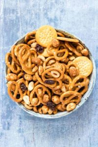 a bowl of cheese snack mix