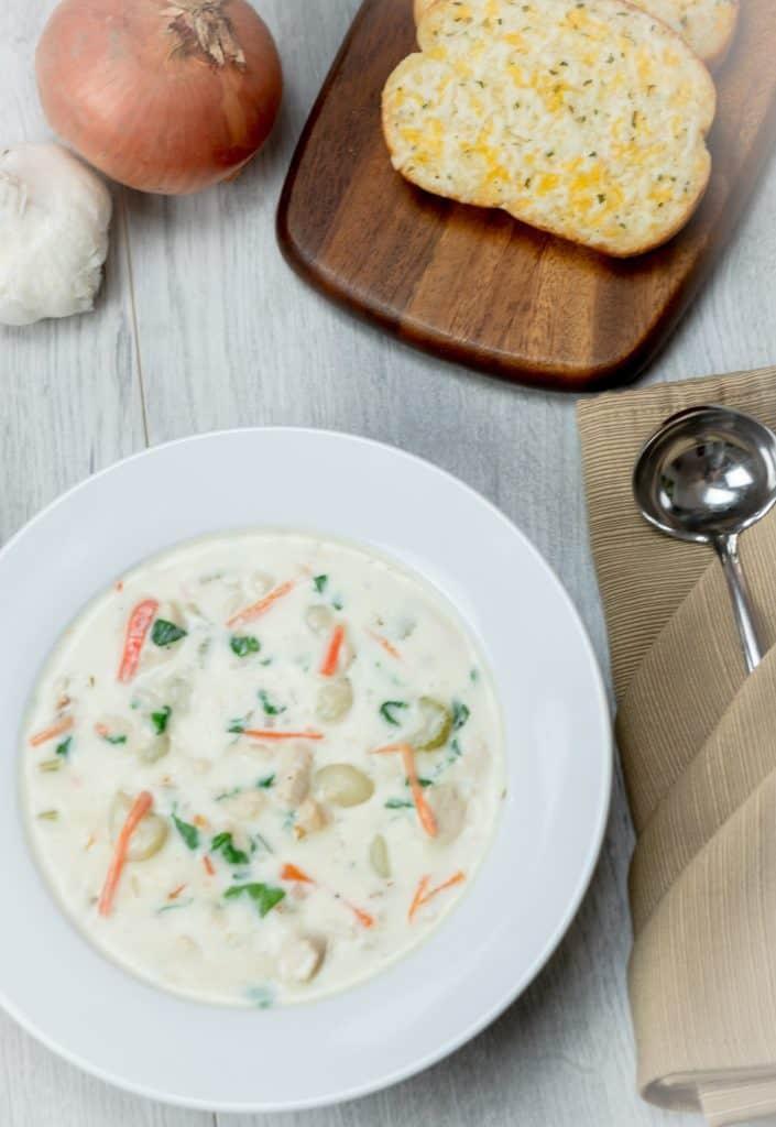 chicken gnocchi soup in a white bowl
