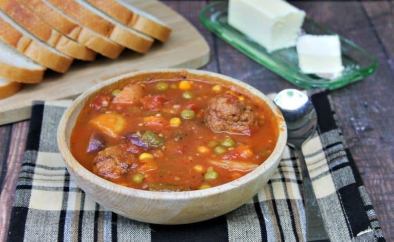 a bowl filled with meatball and potato soup