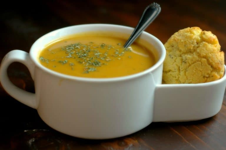 winter vegetable soup in a mug with biscuit holder