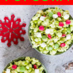 two bowls of green popcorn mixed with marshmallows and red candies
