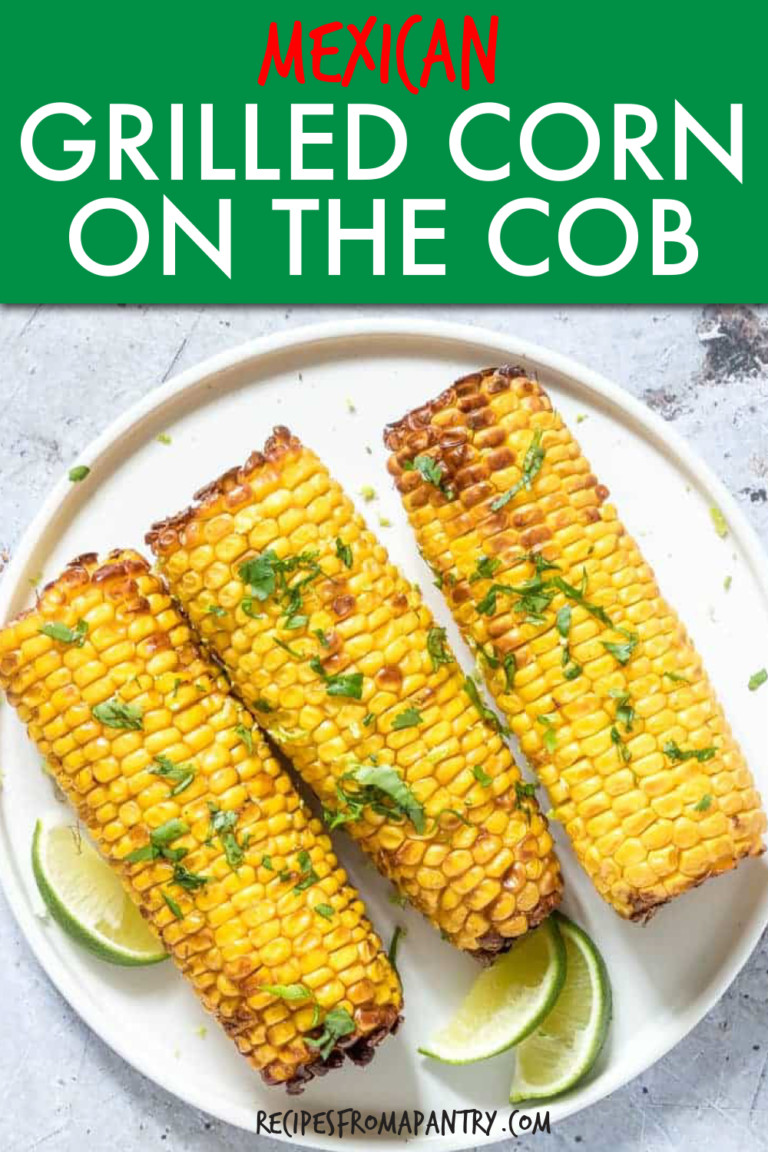 CORN ON THE COB TOPPED WITH CILANTRO ON A PLATE